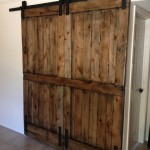 : Rustic knotty alder interior doors look harmonizing in the country house