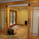 : Solid wood doors with glass panels are great for living rooms and bedrooms
