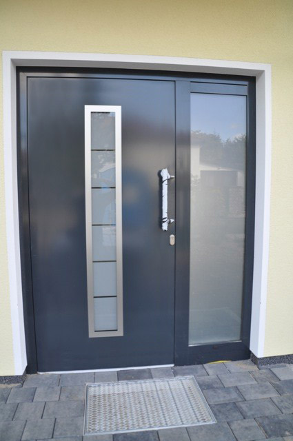 Steel entry doors with sidelights and transom for enhanced protection