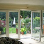 : Tri fold exterior patio doors create a stylish home look