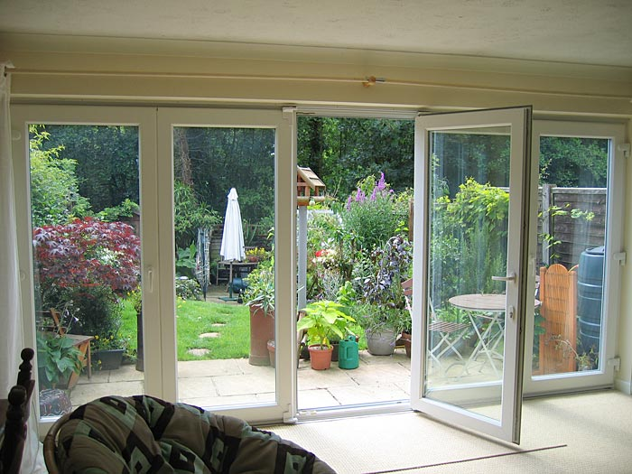 Tri-fold exterior patio doors create a stylish home look