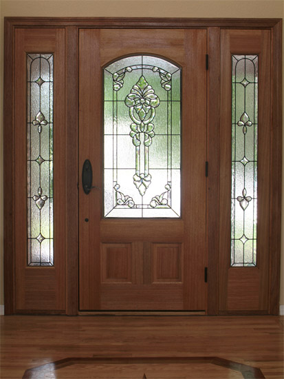 Vintage interior wood doors may be decorated with carving and glass inserts