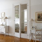 : Vintage internal double doors emphasize the room design very successfully