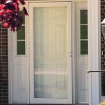 : White wood screen door looks stunning when installed in a house with a garden around