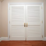 : Wide louvered interior doors have western style
