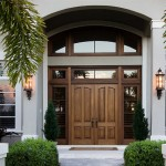 Decorative entry doors with sidelights are very well seen at night