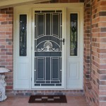 : Decorative front door window inserts can be complemented by blinders