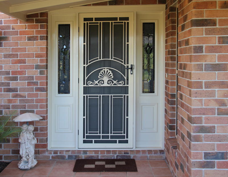 Decorative front door window inserts can be complemented by blinders