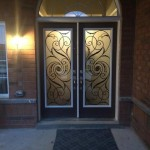 : Decorative front doors with iron inserts look unique