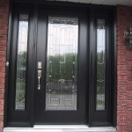 : Decorative front doors with sidelights are accomplished with second doors