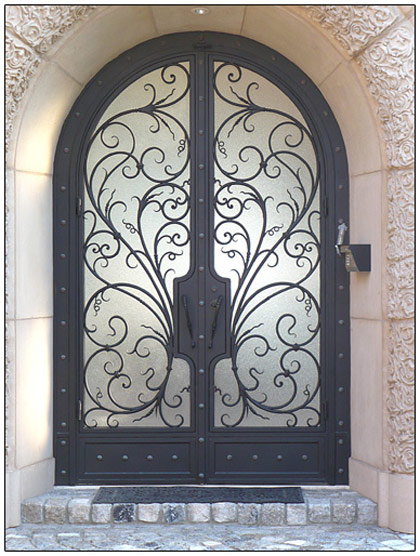 Decorative front doors with wrought iron give old fashioned look