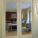 : Glass panel interior pocket door slides in and out of space in the wall