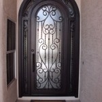Interior steel security doors with wrought iron decorative elements