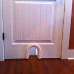 : Small interior cat door will let the cat wandering everywhere