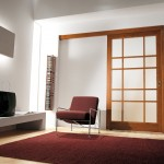 : Wood glass panel interior door may be installed between a living room and a formal dining room