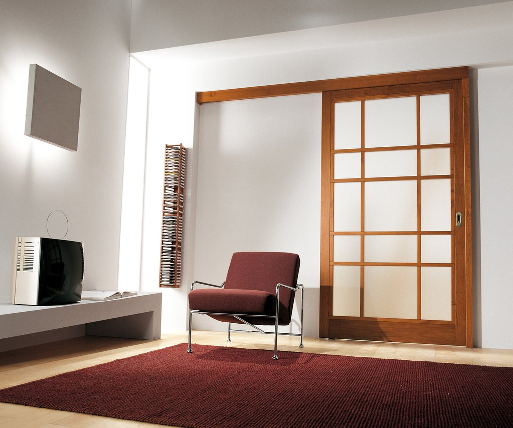 Wood glass panel interior door may be installed between a living room and a formal dining room