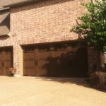 : a big dark wood garage doors