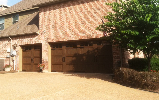 a big dark wood garage doors