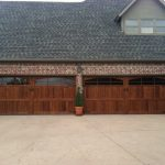 : cedar garage doors in a big house