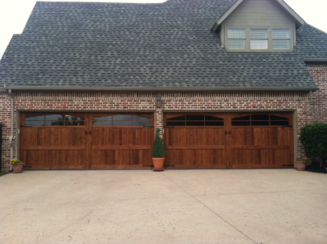 cedar garage doors in a big house