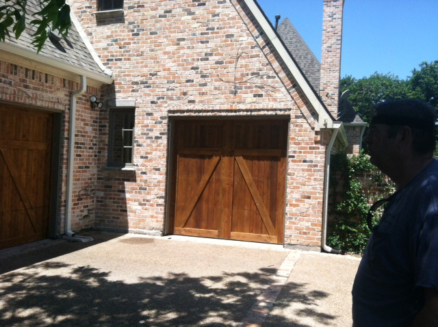 dark cedar garage door in a home