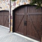 : dark wood garage doors in old country style