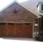 : dark wood garage doors old style