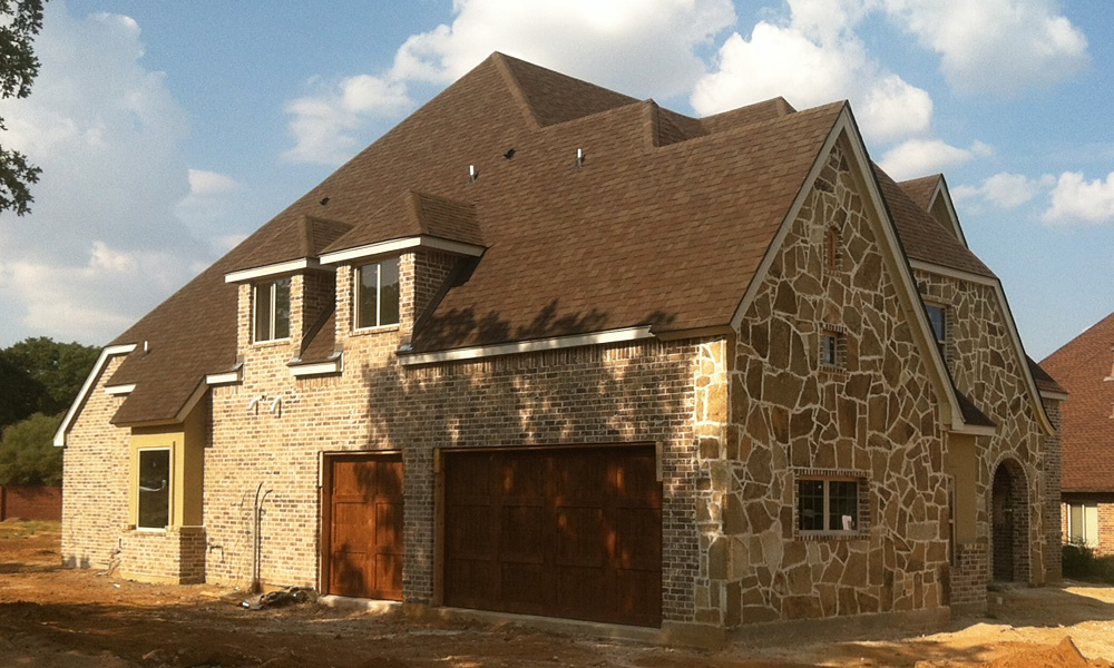 house with dark cedar garage doors