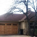 : light cedar garage door with glass