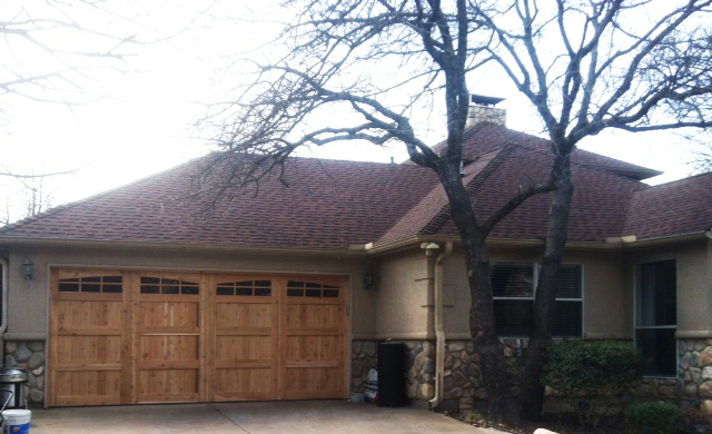 light cedar garage door with glass