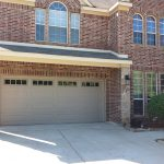 : White metal garage door