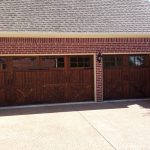 : wood garage door with another coat of stain