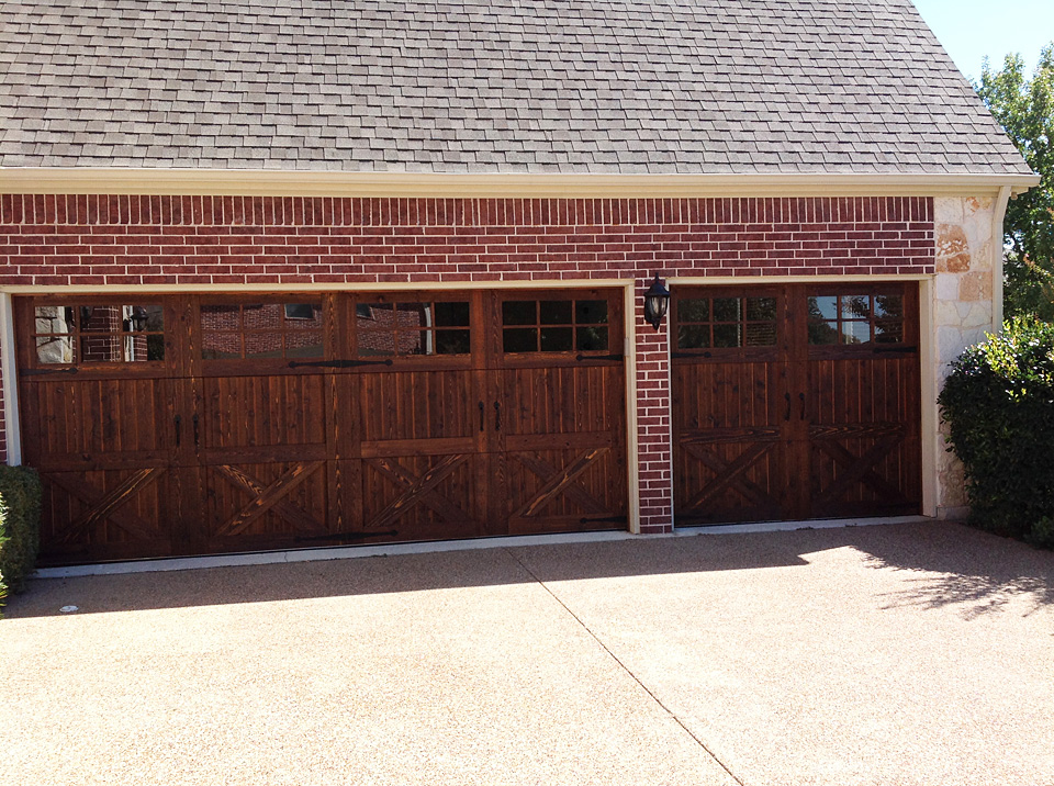 wood garage door with another coat of stain