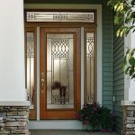 Wood entry door with top glass panel. Paris